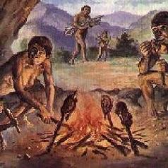 Il fuoco con il cibo e l'uomo primitivo